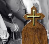 picture of pews  - Metallic cross on pew believers in church - JPG