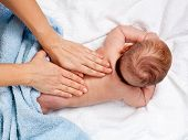 Masseuse massaging 5 months infant