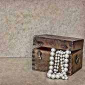 Wooden Chest With Jewels And Pearls On Vintage Background