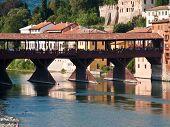 The Old Wooden Bridge Spans The River Brenta At The Romantic Village Basano Del Grappa