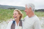 Cheerful senior man and woman at the beach
