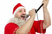 Happy Guy In Santa Suit Singing In Microphone