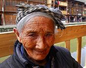 Asian Elderly Woman From The Countryside Of China, Close-up Portrait.