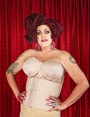 stock photo of girdle  - Big confident drag queen in girdle with hands on hips - JPG