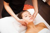 Beautiful woman receiving a facial massage