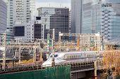 railway with skyline at yurakucho near ginza Tokyo Japan for transportation background