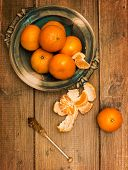 Christmas clementines on wooden board background