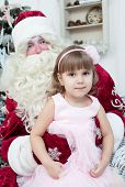 stock photo of saint-nicolas  - Girl in an elegant dress and Saint Nicolas