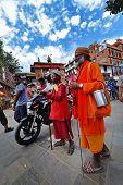Sadhu Men Seeking Alms In Durbar Square. Kathmandu, Nepal