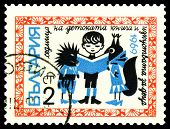 Vintage  Postage Stamp.  Boy Reading To Wolf And Fox.
