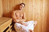 Attractive man relaxing in a sauna in his holidays