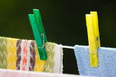 Clean Laundry With Clothespins On Clothesline