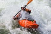 image of rough-water  - an active male kayaker rolling and surfing in rough water - JPG