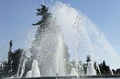 pic of ejaculation  - Water jet in a city park fountain with clear blue sky as background