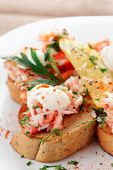 Crab meat with toast, sauce and fresh herbs in plate