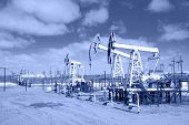 Pump Jack On A Oilfield. Toned.