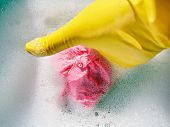 Hand In Yellow Rubber Glove Wrings Out Wet Cloth