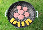 Barbeque Grill With Beef Burger And Corncob