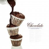 pic of chocolate muffin  - muffins with chocolate sauce over white - JPG