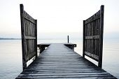 image of dock a pond  - Wooden bridge on a sea dock - JPG
