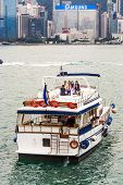 Ship Cruising Victoria Harbor With Party Guests