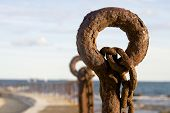 stock photo of bollard  - A rusty bollard and chain - JPG