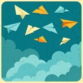 Illustration of paper planes on the sky with clouds.