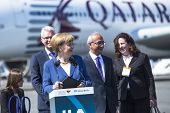 BERLIN, GERMANY - MAY 20, 2014: German Chancellor Angela Merkel (L) open up the International aviation and space exhibition ILA. The aircraft Airbus A350 XWB in background.