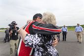 Concord, NC - May 25, 2014:  NASCAR driver, Kurt Busch (26), embraces his family after completing th