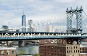 picture of freedom tower  - Manhattan Bridge and Freedom Tower and New York by Gehry Building photographed from a Dumbo Brooklyn Rooftop - JPG