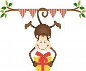 Hanging monkey holding a birthday gift