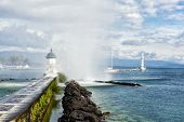 View of Lake Geneva Jet d'Eau fountain and beacon
