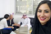 picture of hijabs  - Arabian Businesswoman in office with Businesspeople meeting in the background - JPG