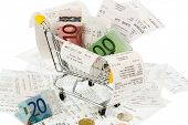 shopping cart, bills and receipts, symbol photo for purchasing power, consumption and inflation