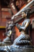 pic of pooja  - Bronze statue in the Golden temple of Patan Nepal - JPG