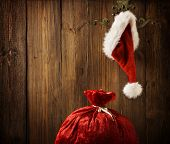 Christmas Santa Claus Hat Hanging On Wood Wall, Xmas Concept, Decoration Over Wooden Backgroud