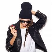 Hipster Girl In Sunglasses And Black Beanie  Smoke Cigar