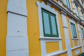 Green windows with yellow wall