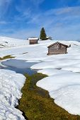 River, Hut And Snow Hills In Alps