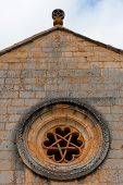 foto of pentacle  - rose window of templar romanesque chapel of San Bartolome in the Lobos river canyon Spain - JPG