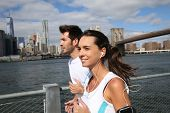 Couple of joggers running on Brooklyn Heights Promenade