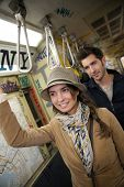 Couple standing in New York City subway train