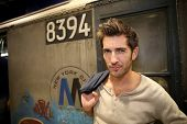 Casual guy standing in New York city subway train