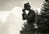 SOCZEWKA, POLAND, CIRCA SIXTIES: Young soldier takes photos during a military training
