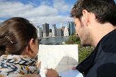 Couple reading city map of New York city