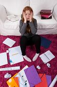 Girl Surrounded By Schoolwork