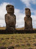 Pair Of Moai Against Blue Sky