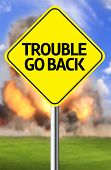 Creative sign with the message - Trouble Go Back