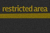 Restricted Area posted on a road