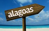 Alagoas, Brazil wooden sign with a beach on background